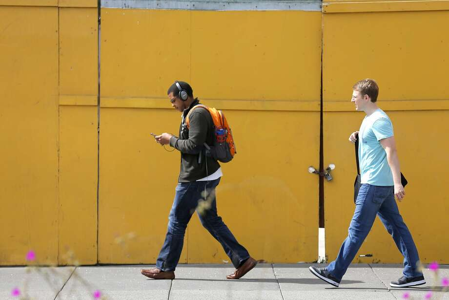 A man uses his cell phone as he walks down the street in San Francisco, California, on Wednesday, Aug. 26, 2015. Photo: Connor Radnovich, The Chronicle