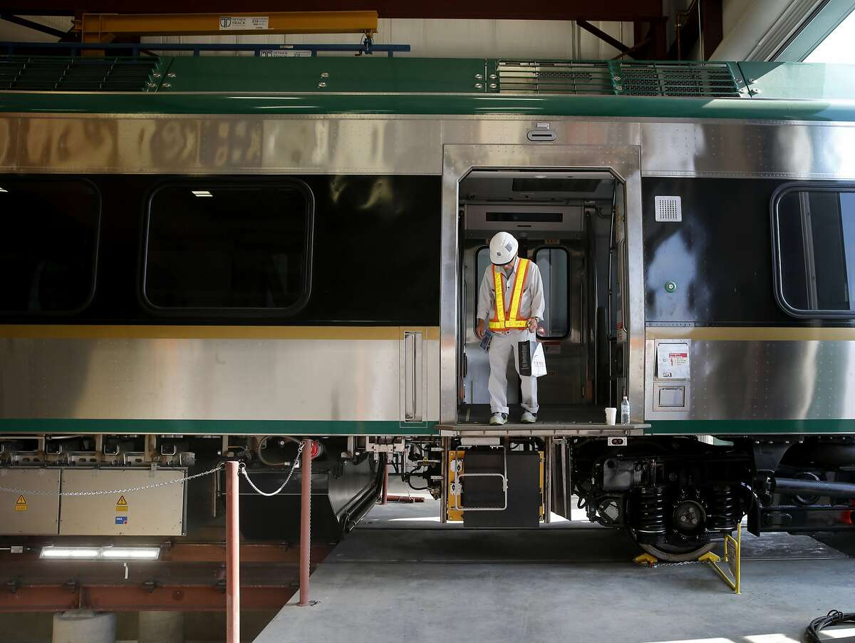A SMART employee prepares to disembark from a train being readied for testing in Santa Rosa, Calif. SMART is a new commuter rail service, due to start late in 2016, between Santa Rosa and San Rafael.