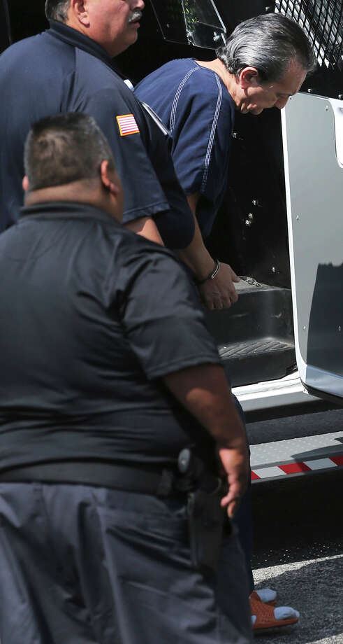 Ex-banker Armando Jesus Hernandez Leal (right, head looking down) exits a van Wednesday August 26, 2015 at the back of the John H. Wood Federal Courthouse. Leal is accused of stealing $66 million he was supposed to invest. Photo: John Davenport, Staff / San Antonio Express-News / ©San Antonio Express-News/John Davenport