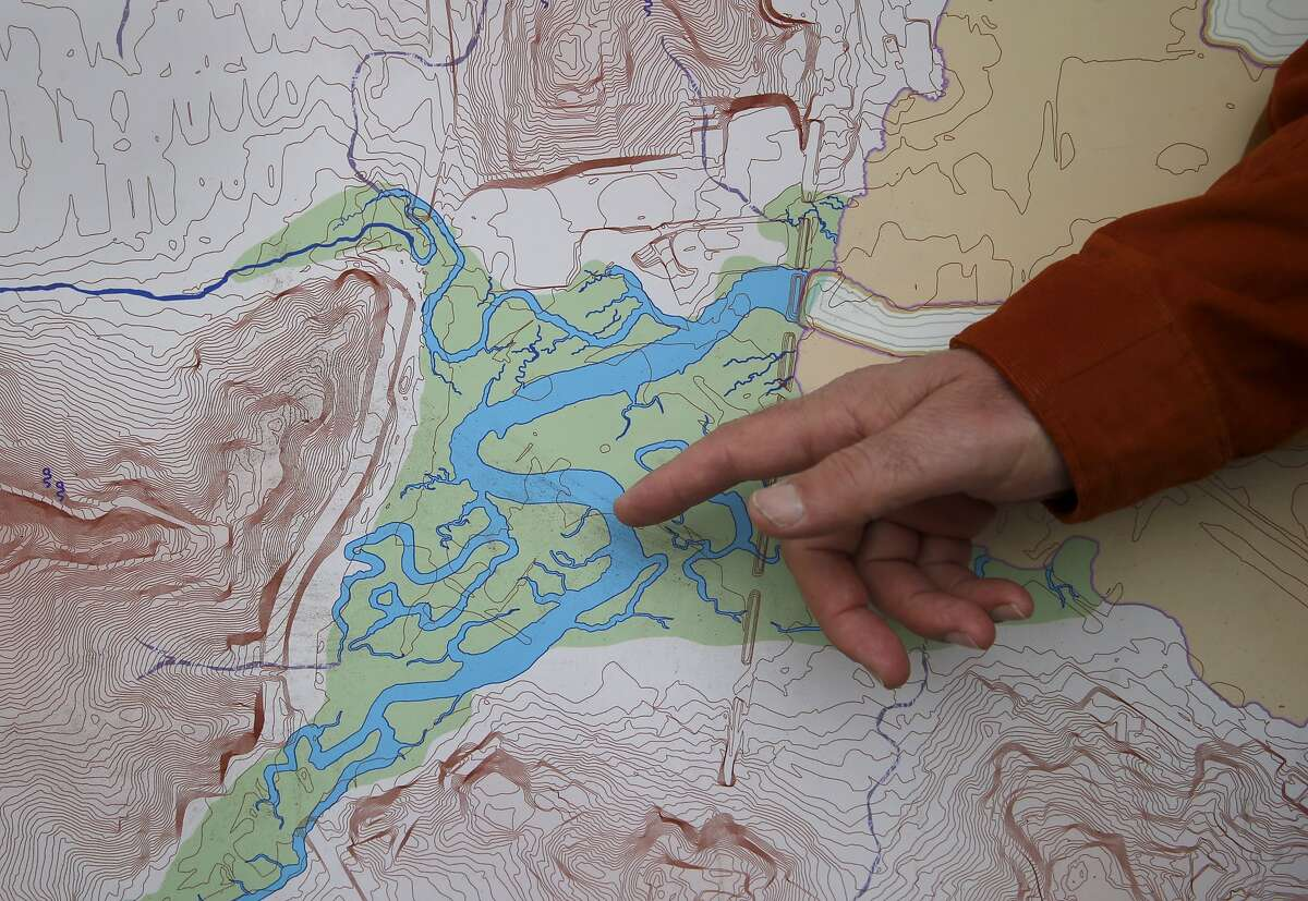 """A large area of underground water on the east side of San Francisco is identified in the Seep City map. Joel Pomerantz has created a wall-sized topographical map called """"Seep City"""" that shows ground water, marshes and lakes and mountains under the pavement of San Francisco."""