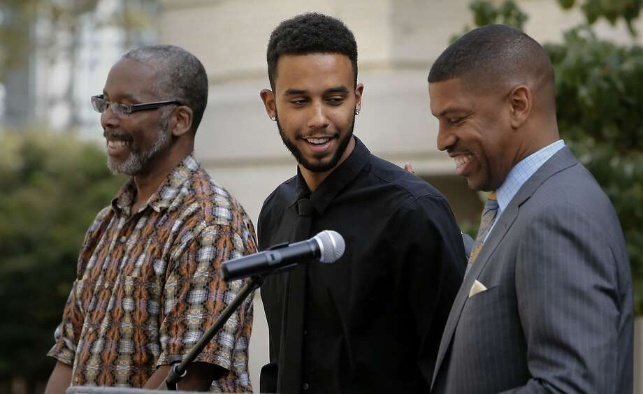 Anthony Sadler, (center) who along with two friends stopped a possible massacre aboard a European train last week in France, is joined by Sacramento Mayor Kevin Johnson, (right) and his father Tony Sadler, (left) during a press conference in his honor at City Hall in Sacramento, Calif. on Wed. August 26, 2015. Photo: Michael Macor, The Chronicle