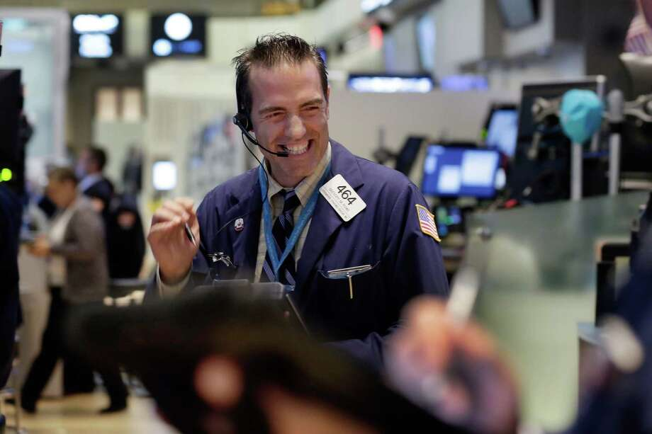 Trader Gregory Rowe works on the floor of the New York Stock Exchange, Wednesday, Aug. 26, 2015. U.S. stocks closed sharply higher, giving the stock market its best day in close to four years. The Dow Jones industrial average climbed 619 points, or 4 percent on Wednesday. (AP Photo/Richard Drew) ORG XMIT: NYRD117 Photo: Richard Drew / AP