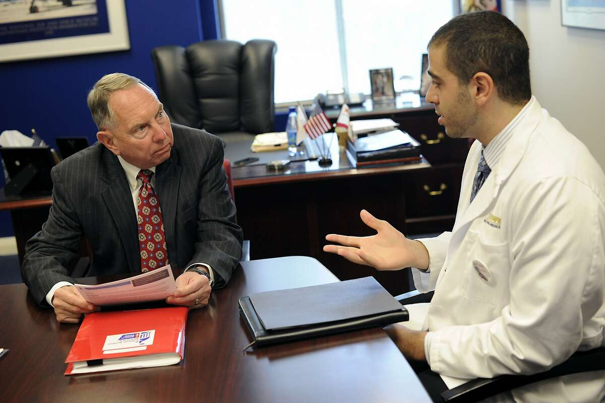 Senator Richard Roth, left, listens to UC Davis medical student John Paul Aboubechara speak as he meets with members of the pro-tobacco tax Save Lives California Coalition in his office at the State Capitol Building in Sacramento, CA Wednesday, August 26, 2015.