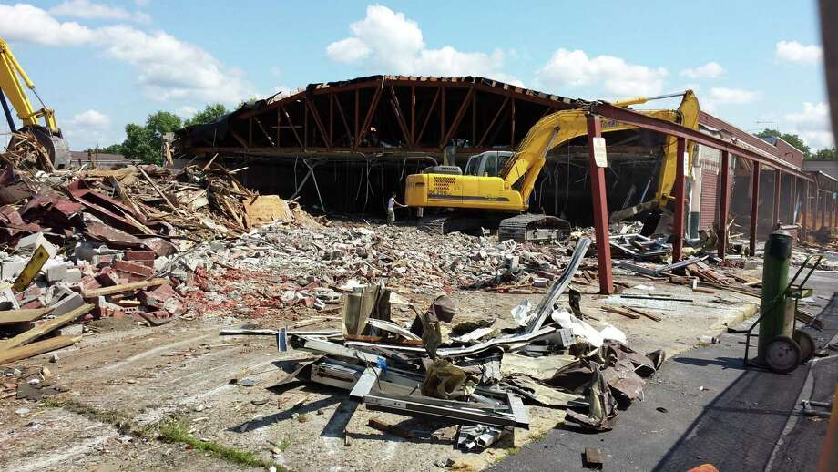 The arched steel skeleton of a former Price Chopper supermarket still stands behind a pile of rubble during demolition on Wednesday in Watervliet. (Eric Anderson / Times Union)