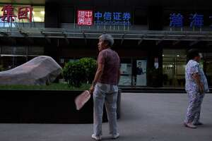 China investigates brokerages - Photo