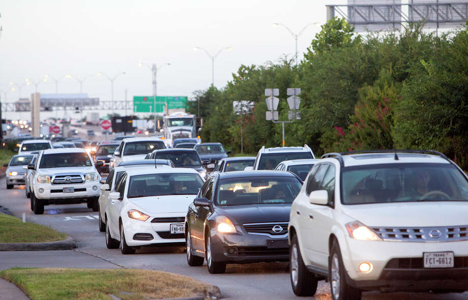 Traffic backs up as authorities investigate a wreck in the 11200 block of Clay Road near the West Sam Houston Parkway, Wednesday, July 22, 2015, in Houston. (Cody Duty / Houston Chronicle) Photo: Cody Duty, Staff / © 2015 Houston Chronicle