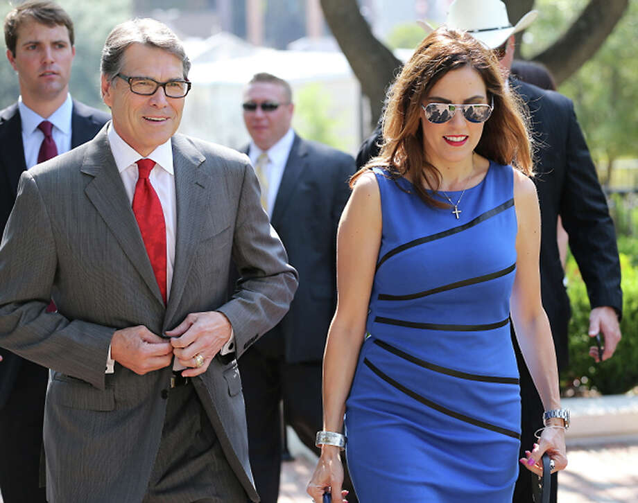 Rick Perry walks with Taya Kyle, widow of Chief Petty Officer Chris Kyle, before a ceremony honoring the fallen Texas hero Wednesday in Austin. Photo: Ralph Barrera, MBO / Austin American-Statesman
