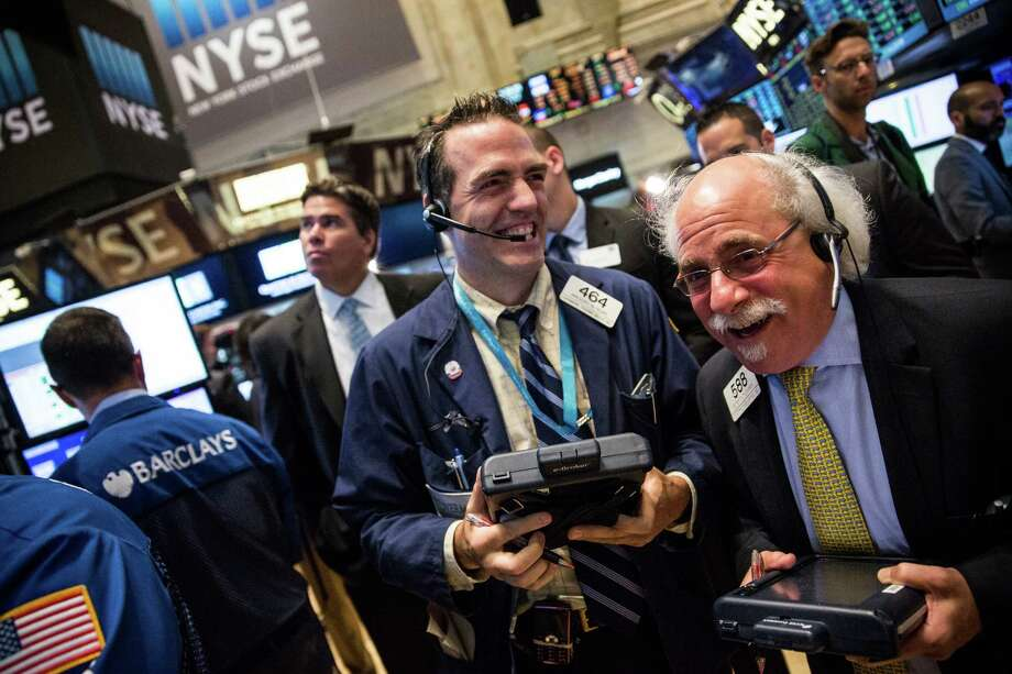 Relieved traders work on the floor of the New York Stock Exchange on Wednesday. Photo: Andrew Burton /Getty Images / 2015 Getty Images