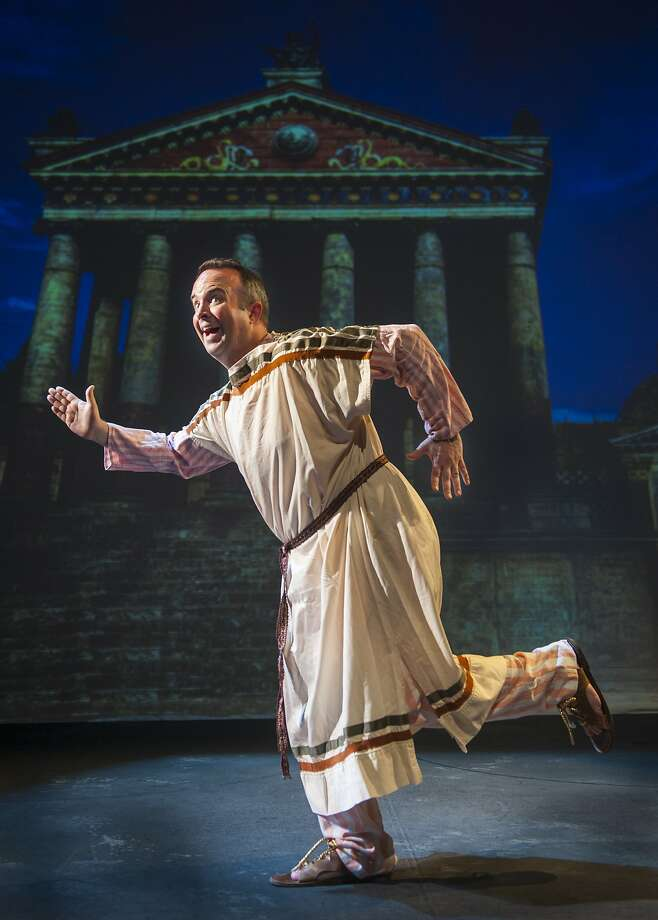 """Doug Santana as the slave Pseudolus in Foothill Music Theatre's """"A Funny Thing Happened on the Way to the Forum."""" Photo: David Allen"""