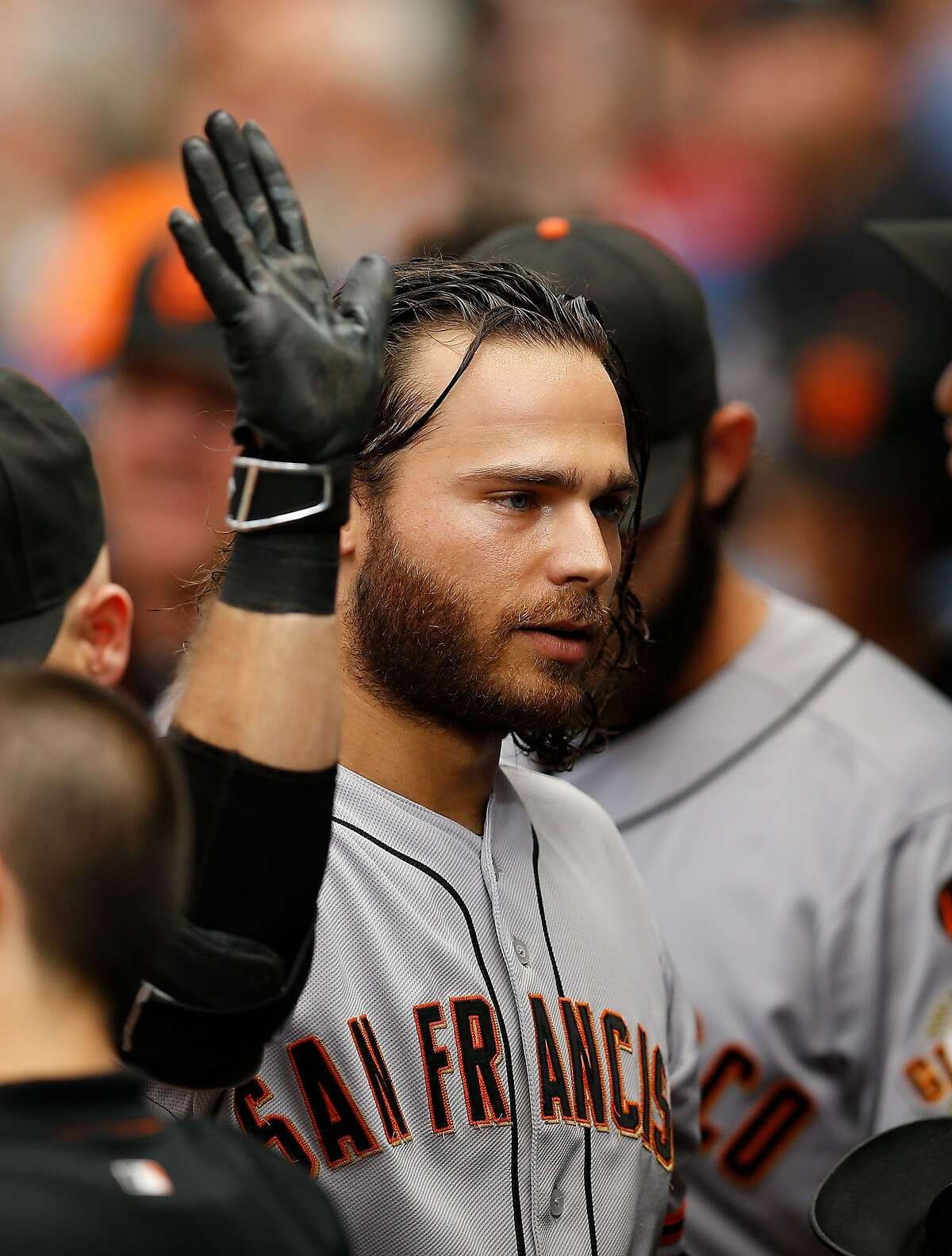 ATLANTA, GA - AUGUST 03: Brandon Crawford #35 of the San Francisco Giants is congratulated in the dugout after hitting a solo home run in the second inning during the game against the Atlanta Braves at Turner Field on August 3, 2015 in Atlanta, Georgia. (Photo by Mike Zarrilli/Getty Images)