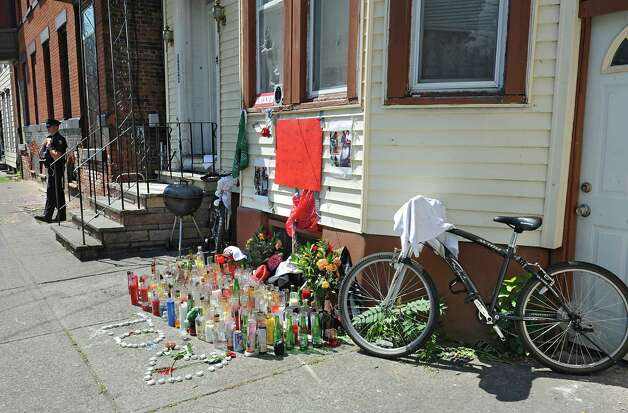 """A memorial for Thaddeus """"T.O."""" Faison is seen in its third location near the corner of Glen Ave. and 7th Ave. on Wednesday, Aug. 26, 2015 in Troy, N.Y. Faison died in a police shoot out near the intersection of 112th Street and Fifth Avenue. (Lori Van Buren / Times Union) ORG XMIT: MER2015082616560125 Photo: Lori Van Buren / 00033142A"""