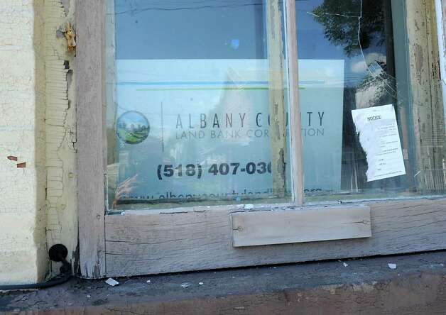 Sign in window at 45 Main St. on Wednesday, Aug. 26, 2015 in Cohoes, N.Y. (Albany County made an official presentation to its land bank to continue its financial commitment and Albany County. (Lori Van Buren / Times Union) Photo: Lori Van Buren / 00033145A