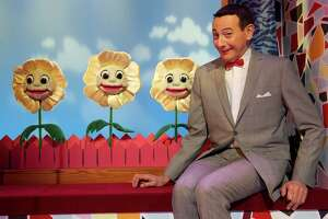 """In this Friday, Oct. 29, 2010 photo, Paul Reubens, in character as Pee-wee Herman, poses on stage after a performance of """"The Pee-wee Herman Show"""" on Broadway in New York. (AP Photo/Charles Sykes)"""