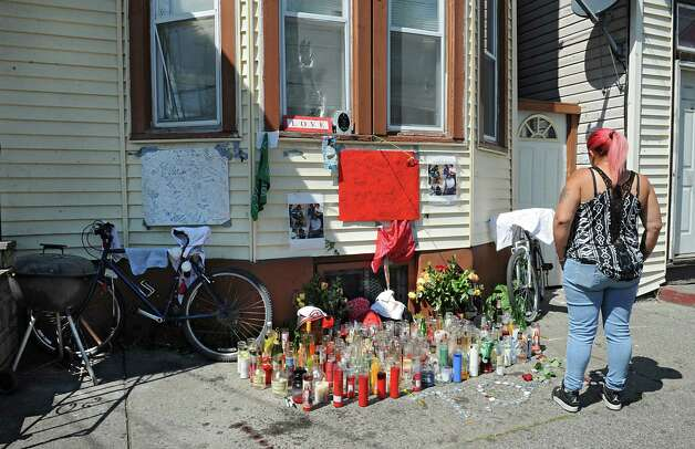 """A memorial for Thaddeus """"T.O."""" Faison is seen in its third location near the corner of Glen Ave. and 7th Ave. on Wednesday, Aug. 26, 2015 in Troy, N.Y. Faison died in a police shoot out near the intersection of 112th Street and Fifth Avenue. (Lori Van Buren / Times Union) Photo: Lori Van Buren / 00033142A"""