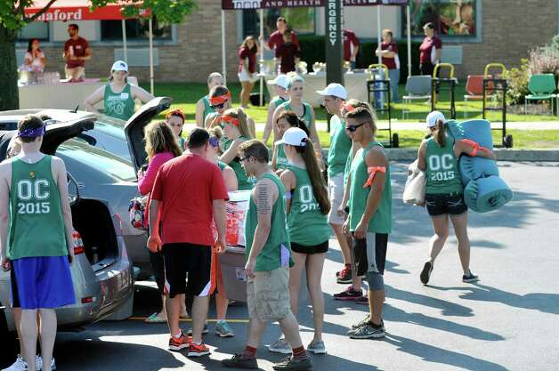 Members of the Albany College of Pharmacy and Health Sciences orientation committee cars as first year students moved into their residence halls on Wednesday, Aug. 26, 2015 in Albany, N.Y.  All other students will move in on Thursday.  (Paul Buckowski / Times Union) Photo: PAUL BUCKOWSKI / 00033111A
