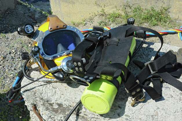 Diving equipment used by the state Department of Environmental Conservation to removed cars from the Hudson River which were mostly covered with zebra mussels on Wednesday, Aug. 26, 2015 in Troy, N.Y. Some of the cars were stolen. (Lori Van Buren / Times Union) Photo: Lori Van Buren / 00033141A