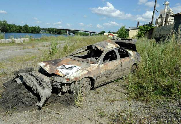 The state Department of Environmental Conservation removed cars from the Hudson River which were mostly covered with zebra mussels on Wednesday, Aug. 26, 2015 in Troy, N.Y. Some of the cars were stolen. (Lori Van Buren / Times Union) Photo: Lori Van Buren / 00033141A