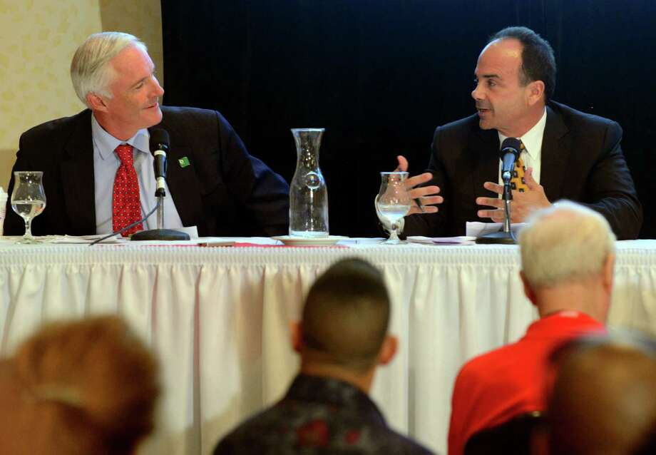 Bridgeport Mayor Bill Finch, left, and former Mayor Joseph Ganim engage in a heated debate over taxes as they and businesswoman Mary-Jane Foster take part in a forum co-sponsored by AARP, the Greater Bridgeport Latino Network and the NAACP at the Holiday Inn in downtown Bridgeport, Conn., on Wednesday Aug. 26, 2015. Finch, Ganim, and Foster will face off in a Democratic mayoral primary on Sept. 16th. Photo: Christian Abraham, Hearst Connecticut Media / Connecticut Post