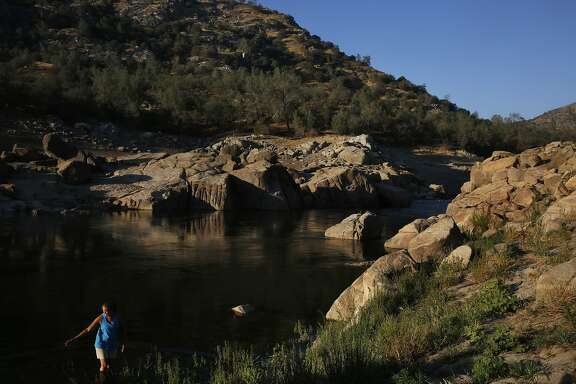 Anita Lodge wades in the cool waters of the San Joaquin river near her family's home at Temperance Flat July 16, 2015 near Auberry, Calif. The water turns back into a river when Millerton Lake is as low as it currently is. The proposed Temperance Flat dam would be built above Millerton Lake along the San Joaquin river and it would hold about 1.2 million acre feet of water. The dam would also flood the land where Anita Lodge's family's home is located. Brought to the area during the gold rush, the family settled in the area in the 1860s. Over the years, their 320 acres has shrunk down to just seven. The land includes the home Lodge's father built in the 1970s. The family cherishes the land and their home, which between Lodge, her sister and her daughter is always occupied. They have been fighting the building of the dam for about twelve years now.
