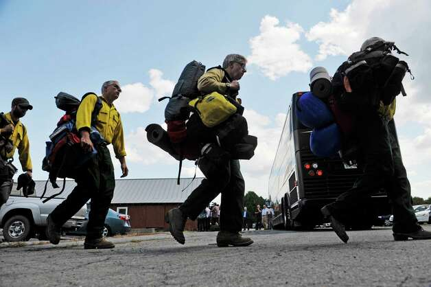 DEC forest rangers and employees who have been out in Oregon fighting wildfires returned to the Saratoga Tree Nursery on Wednesday, Aug. 26, 2015 in Saratoga Springs, N.Y.  The team spent the last two weeks fighting the Stouts Creek Wildfire.  (Paul Buckowski / Times Union) Photo: PAUL BUCKOWSKI / 00033129A