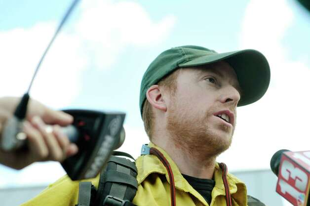 State New York State DEC State Forest Ranger Michael Thompson talks to members of the media, as DEC forest rangers and employees who have been out in Oregon fighting wildfires returned to the Saratoga Tree Nursery on Wednesday, Aug. 26, 2015 in Saratoga Springs, N.Y.  The team spent the last two weeks fighting the Stouts Creek Wildfire.  (Paul Buckowski / Times Union) Photo: PAUL BUCKOWSKI / 00033129A