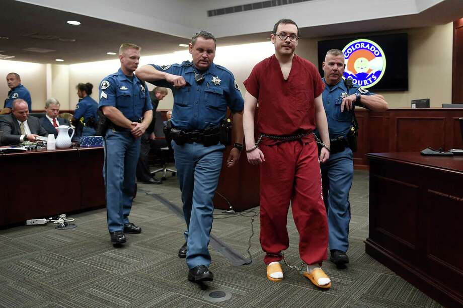 James Holmes is led out of the courtroom after being formally sentenced on more than 160 counts in the 2012 Aurora movie theater shooting. A jury this month ruled out the death penalty in the case. Photo: RJ Sangosti /New York Times / POOL