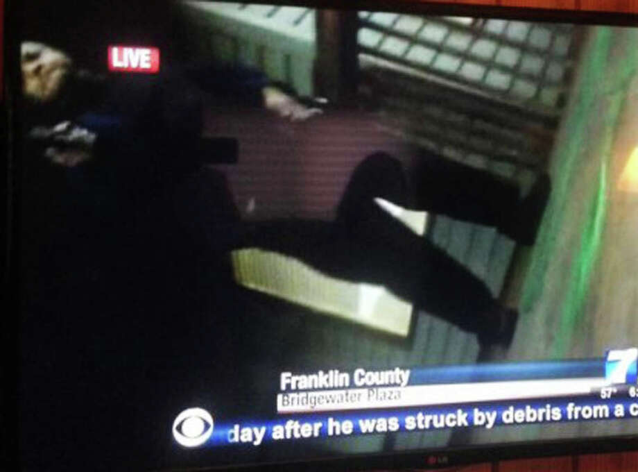 RETRANSMISSION TO CORRECT ORIENTATION OF IMAGE - In this framegrab from video made by the camera of WDBJ-TV cameraman Adam Ward, Vester Lee Flanagan II stands over Ward with a gun after fatally shooting him and reporter Alison Parker during a live on-air interview in Moneta, Va., Wednesday, Aug. 26, 2015. Flanagan, who had been an employee at WDBJ and appeared on air as Bryce Williams, posted his own video of the attack on his social media accounts after fleeing the scene. (Twitter via AP) ORG XMIT: NYAJ305 / WDBJ