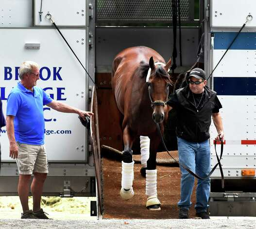 Assistant trainer Jim Barnes leads American Pharoah from the trailer upon his arrival at the Saratoga Race Course Wednesday afternoon Aug. 26, 2015 in Saratoga Springs, N.Y.       (Skip Dickstein/Times Union) Photo: SKIP DICKSTEIN