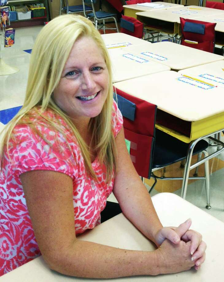 New Milford Teacher of the Year Jennifer Singer sits in her Sarah Noble Intermediate School classroom several weeks after having her second baby. Noble Intermediate School classroom. Photo: Norm Cummings / Hearst Connecticut Media / The News-Times