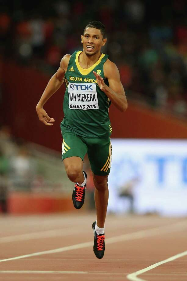 BEIJING, CHINA - AUGUST 26:  Wayde Van Niekerk of South Africa crosses the finish line to win gold in the Men's 400 metres final during day five of the 15th IAAF World Athletics Championships Beijing 2015 at Beijing National Stadium on August 26, 2015 in Beijing, China.  (Photo by Patrick Smith/Getty Images) ORG XMIT: 565940717 Photo: Patrick Smith / 2015 Getty Images