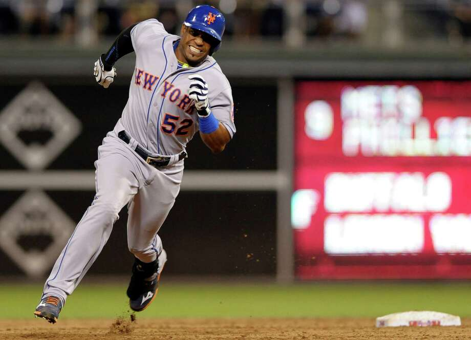 New York Mets' Yoenis Cespedes rounds second base after hitting a triple to score Curtis Granderson in the ninth inning of a baseball game against the Philadelphia Phillies, Wednesday, Aug. 26, 2015, in Philadelphia. The Mets won 9-4. (AP Photo/Michael Perez) ORG XMIT: PAMP113 Photo: Michael Perez / FR168006 AP