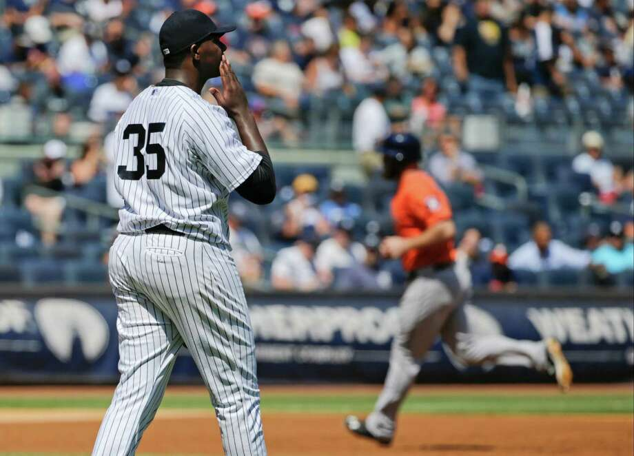 New York Yankees starting pitcher Michael Pineda (35) reacts as Houston Astros' Evan Gattis runs the bases after hitting a home run during the second inning of a baseball game Wednesday, Aug. 26, 2015, in New York. (AP Photo/Frank Franklin II) ORG XMIT: NYY107 Photo: Frank Franklin II / AP