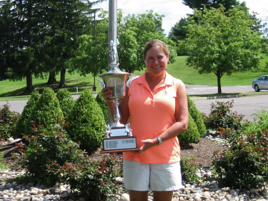Nancy Kroll of Pinehaven holds the championship trophy after winning the Northeastern Women's Golf Association championship Wednesday, Aug. 26, 2015, at Normanside. (Photo courtesy NEWGA)