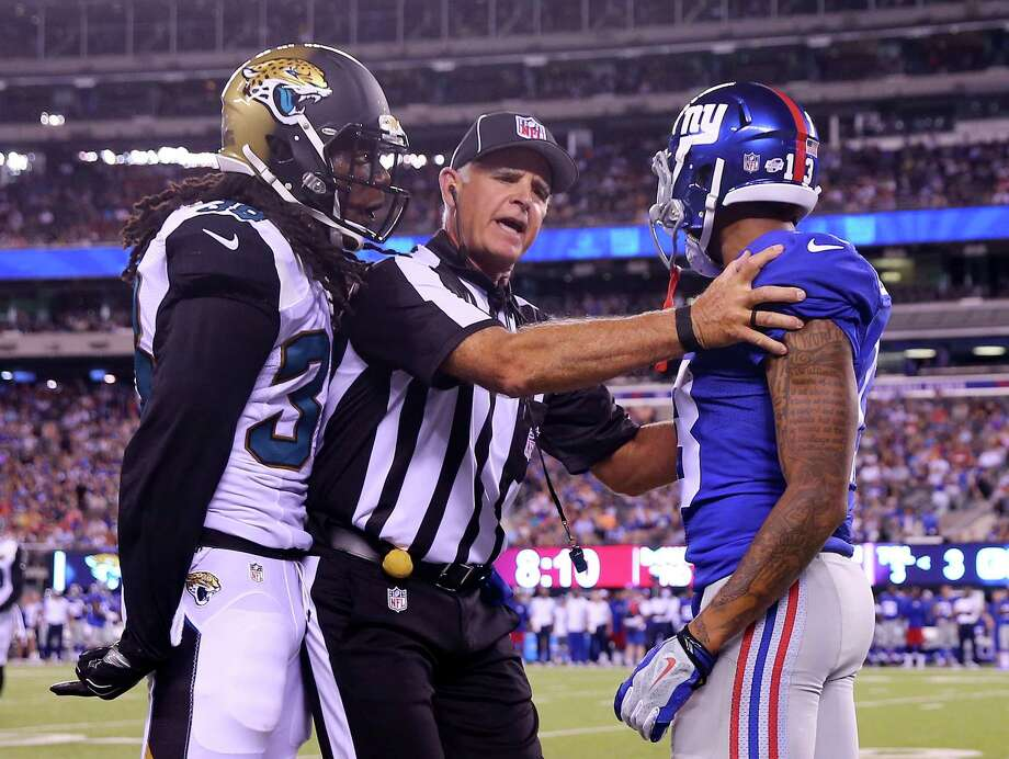 EAST RUTHERFORD, NJ - AUGUST 22:  Sergio Brown #38 of the Jacksonville Jaguars and  Odell Beckham #13 of the New York Giants exchange words after a play in the second quarter of preseason action at MetLife Stadium on August 22, 2015 in East Rutherford, New Jersey.  (Photo by Elsa/Getty Images) ORG XMIT: 564374465 Photo: Elsa / 2015 Getty Images
