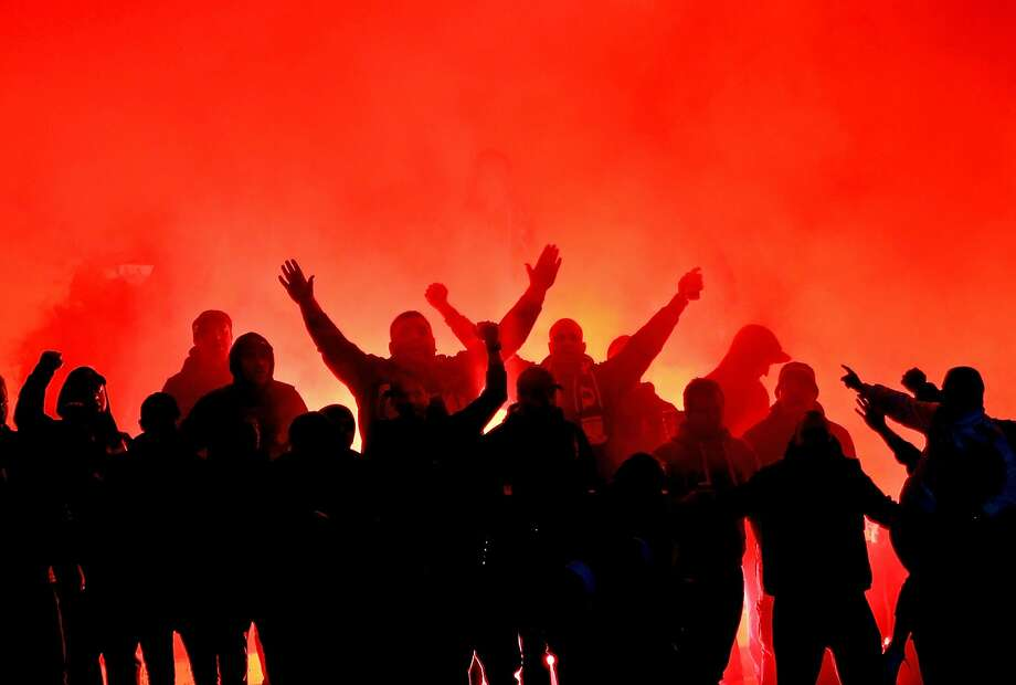 Fans in the crowd let off flares during the FFA Cup Round of 16 match between Heidelberg United and Sydney United 58 FC at Olympic Village on August 26, 2015 in Melbourne, Australia. Photo: Scott Barbour