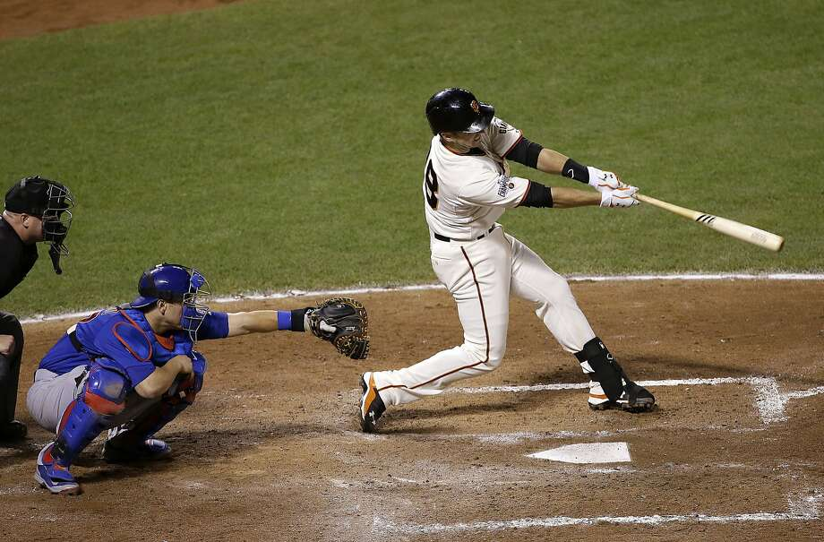 Buster Posey belts a double to drive in the go-ahead run. Photo: Jeff Chiu, Associated Press