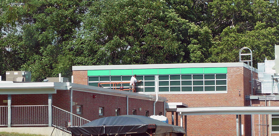 Finishing touches are being put on Osborn Hill School in preparation for the first day of school. Gone are the portable classrooms that have served as the gym while PCB contamination was remediated. Photo: Genevieve Reilly / Genevieve Reilly / Fairfield Citizen
