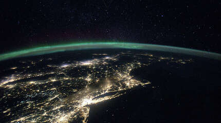 The Northern Lights can be seen near the North Pole. New York City stands out with the bright lights. Long Island, Connecticut, Cape Cod, even the Maine coast can be seen.