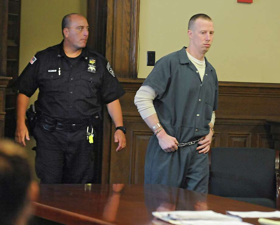 Jacob Heimroth enters the courtroom at the Rensselaer County Courthouse for his arraignment on the deaths of Maria and Allen Lockrow in their Lansingburgh home last summer on Thursday, Aug. 27, 2015 in Troy, N.Y. Heimroth was arraigned on 1st and 2nd degree murder along with other felonies. (Lori Van Buren / Times Union) Photo: Lori Van Buren / 00033143A