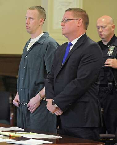 Jacob Heimroth stands with public conflict defender Joseph Ahearn in a courtroom at the Rensselaer County Courthouse for his arraignment on the deaths of Maria and Allen Lockrow in their Lansingburgh home last summer on Thursday, Aug. 27, 2015 in Troy, N.Y. Heimroth was arraigned on 1st and 2nd degree murder along with other felonies. (Lori Van Buren / Times Union) Photo: Lori Van Buren / 00033143A