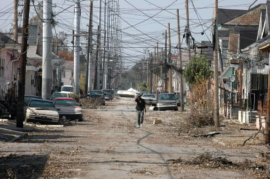 A depressed New Orleans resident ( refused to give name), walks the streets of his New Orleans neighborhood Friday morning in search of any signs of his life before the hurricane Katrina destruction, Sept. 16, 2005 (Steve Jacobs / Times Union)