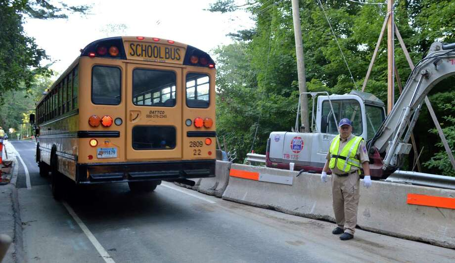 No major delays were reported Thursday as school buses, and other traffic, moved across the North Avenue bridge via an alternati ng, one-lane pattern throughout the day. Reconstruction of the span over the Merritt Parkway is months behind schedule, and if the span had remained totally closed -- as state officials initially planned -- school officials had warned of major school bus delays with the start of the new school year Thursday. Photo: Jarret Liotta / For Hearst Connecticut Media / Westport News