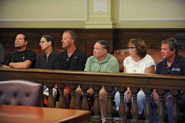 Family members of Maria and Allen Lockrow listen to Judge Andrew Ceresia during the arraignment of Jacob Heimroth in a courtroom at the Rensselaer County Courthouse on Thursday, Aug. 27, 2015 in Troy, N.Y. Heimroth was arraigned on 1st and 2nd degree murders along with other felonies relating to the death of Maria and Allen Lockrow in their Lansingburgh home last summer. (Lori Van Buren / Times Union) Photo: Lori Van Buren / 00033143A