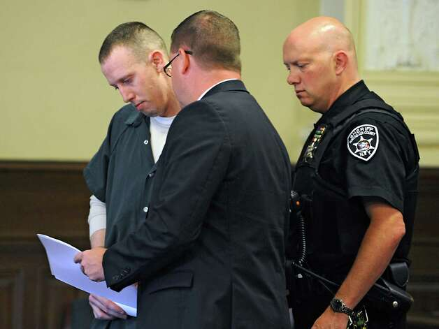 Jacob Heimroth, left, talks with public conflict defender Joseph Ahearn in a courtroom at the Rensselaer County Courthouse for his arraignment on the deaths of Maria and Allen Lockrow in their Lansingburgh home last summer on Thursday, Aug. 27, 2015 in Troy, N.Y. Heimroth was arraigned on 1st and 2nd degree murder along with other felonies. (Lori Van Buren / Times Union) Photo: Lori Van Buren / 00033143A