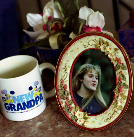 A photograph of Suzanne Lyall remains on an end table at the home of her parents Doug and Mary Lyall Tuesday, July 24, 2001, in Milton, N.Y. Suzanne has been missing since March 2, 1998. (Cindy Schultz/Times Union) Photo: CINDY SCHULTZ / ALBANY TIMES UNION