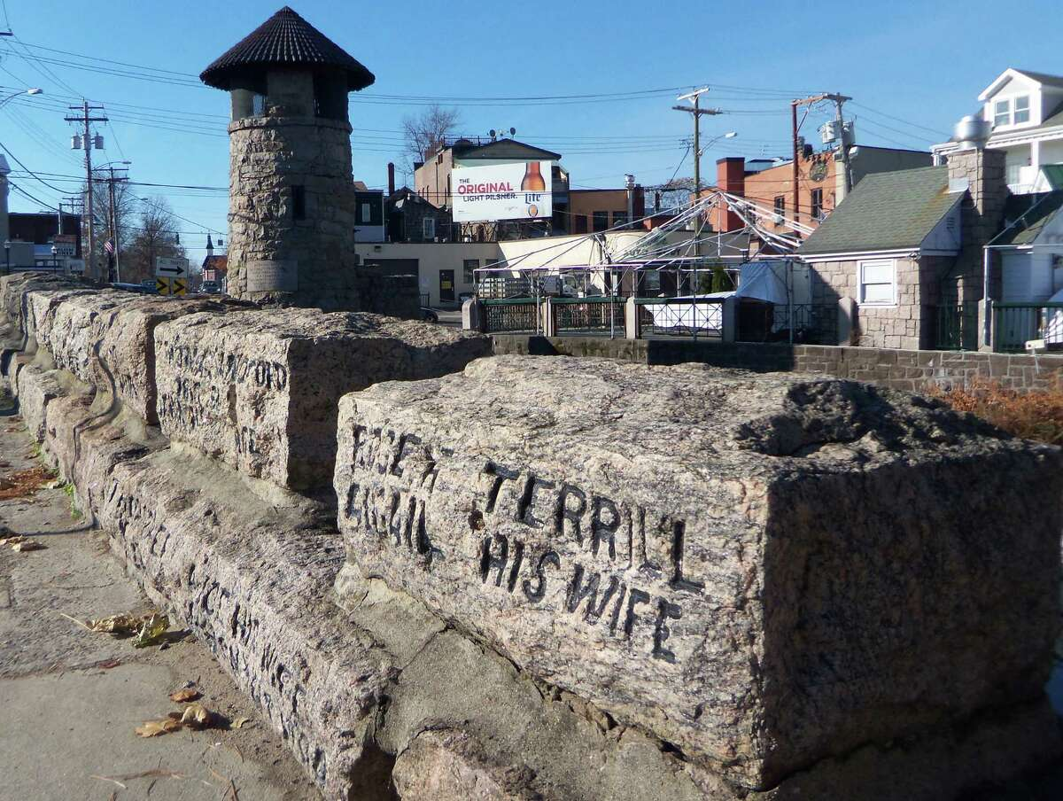 Built in 1889, the Memorial Bridge along New Haven Avenue in Downtown Milford, Conn. has the names of most, but not all, of the founders of the city carved into its stonework. The last of the six names were recently added to a plaque nearby.