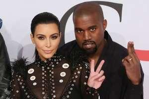 Kim Kardashian and Kanye West settle engagement video case - Photo