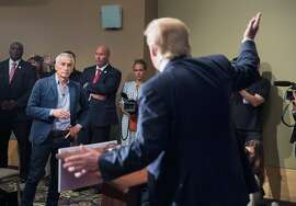 DUBUQUE, IA - AUGUST 25:  Republican presidential candidate Donald Trump fields a question from Univision and Fusion anchor Jorge Ramos during a press conference held before his campaign event at the Grand River Center on August 25, 2015 in Dubuque, Iowa. Earlier in the press conference Trump had Ramos removed from the room when he failed to yield when Trump wanted to take a question from a different reporter. Trump leads most polls in the race for the Republican presidential nomination.  (Photo by Scott Olson/Getty Images) *** BESTPIX ***