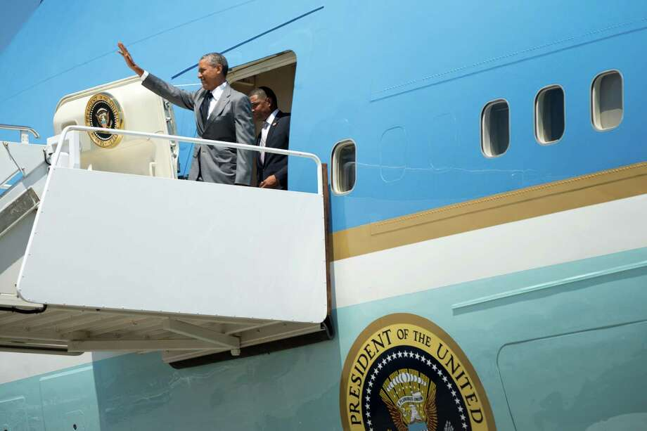 President Barack Obama waves as he gets off Air Force One upon his arrival at Louis Armstrong International Airport in New Orleans, Thursday, Aug. 27, 2015, for the 10th anniversary since the devastation of Hurricane Katrina. Photo: Andrew Harnik, AP / AP