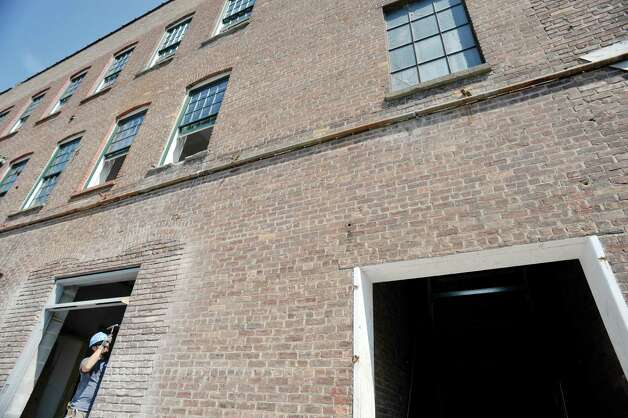 A view of the outside of the former Tilley Ladder Co. building on Wednesday, Aug. 19, 2015, in Watervliet, N.Y.  The building is being turned into apartments.   (Paul Buckowski / Times Union) Photo: PAUL BUCKOWSKI / 00033040A